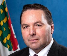Minister Wally Schumann