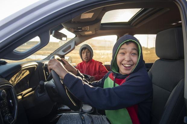 Silverado Launch - Kids sit in truck as it gets ready to drive down the Inuvik-Tuktoyaktuk Highway