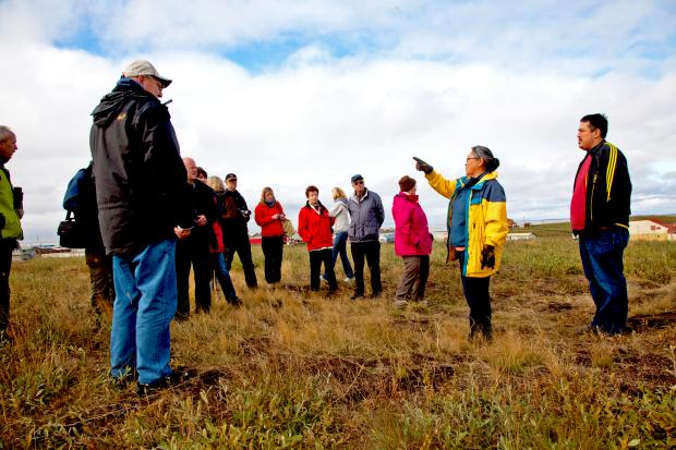 Tourists staring at a Pingo in Tuktoyaktuk