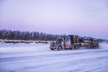 Truck travelling down ice road in the Northwest Territories