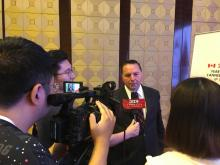 Wally Schumann speaks with media in China
