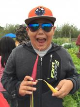 A happy participant at the Youth Gardening Camp