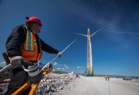 Construction Worker Working on a Wind Farm