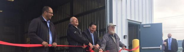 Mohan Dennetto (INAC), Dave Nickerson, Minister of ITI Wally Schumann, and Walt Humphries Cutting Ribbon at Geological Materials Storage Facility